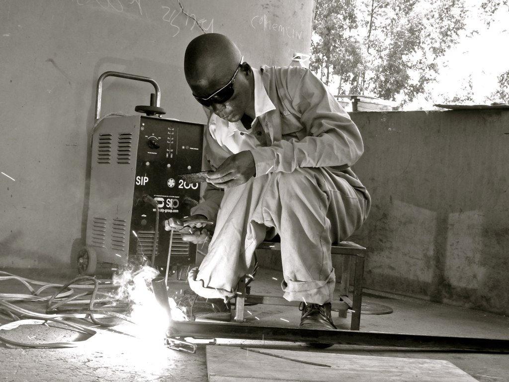 Joseph Okumu - welding in Kiboswa